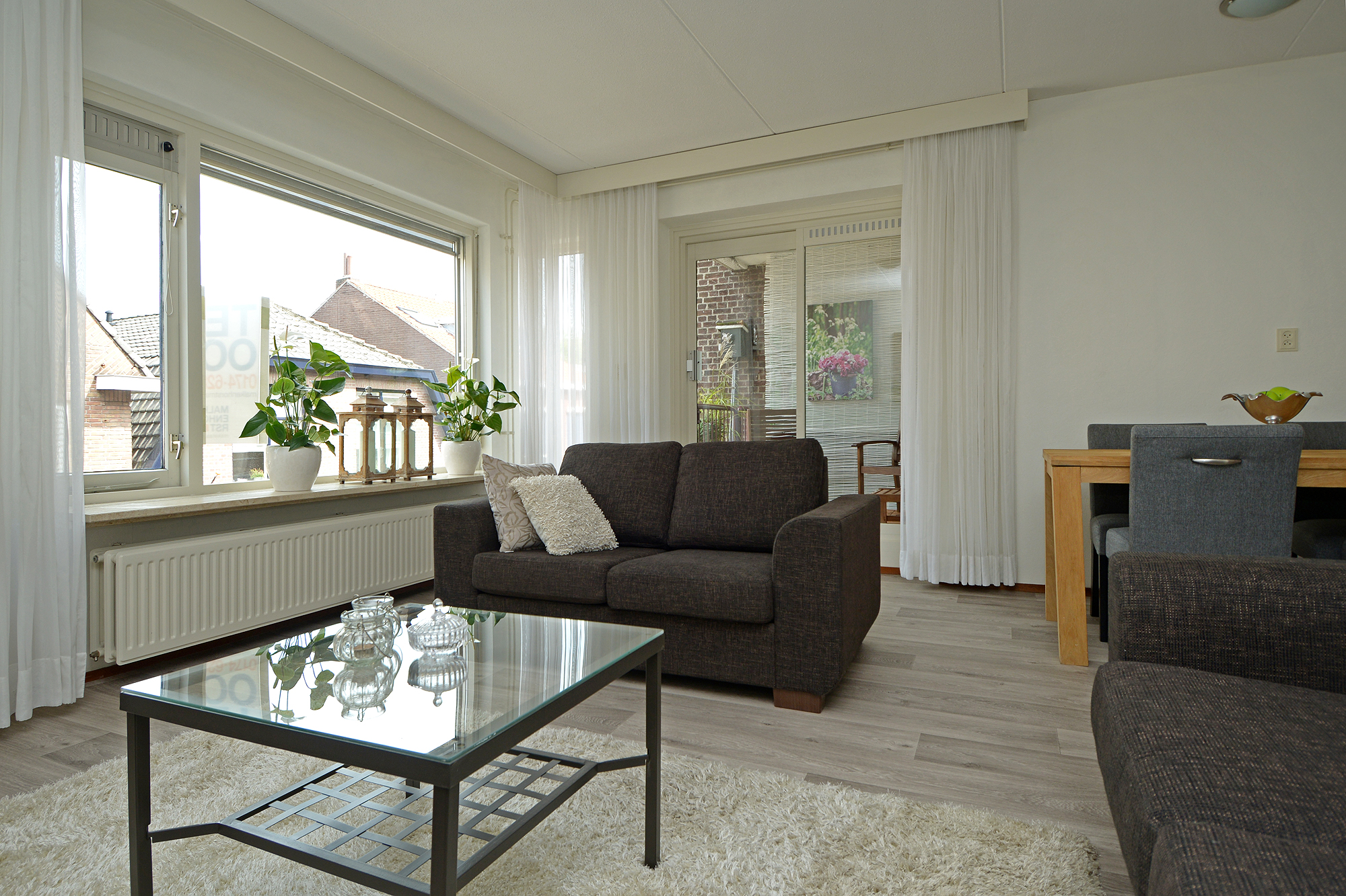 Woonkamer appartement, na restyling | MooiVerkocht.nl